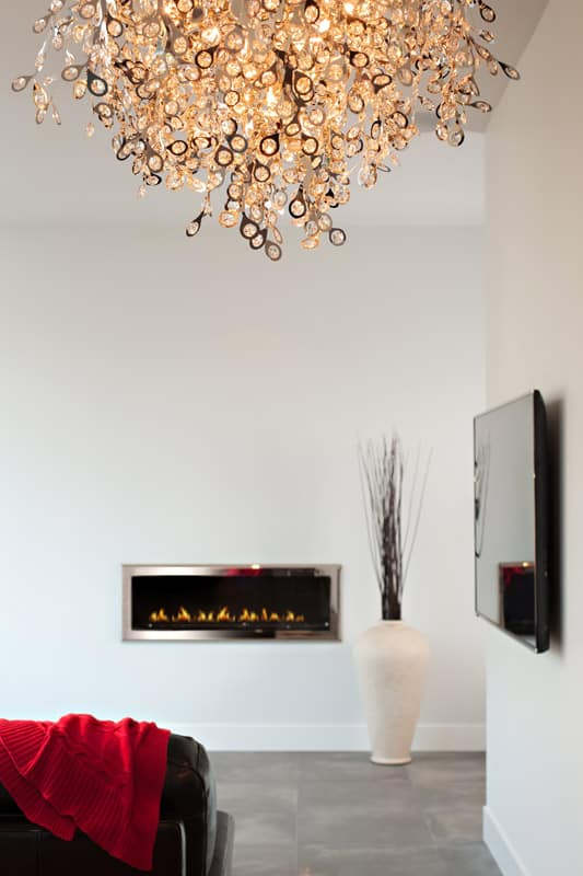 Fire place chandelier after home renovation Doran in North Vancouver BC Shakespeare Homes